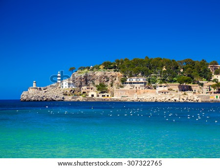 beautiful landscape with a small lighthouse at the pier of Port de Soller, Majorca, Spain - stock photo