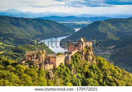 Beautiful landscape with Aggstein castle ruin and Danube river at sunset in Wachau, Austria - stock photo