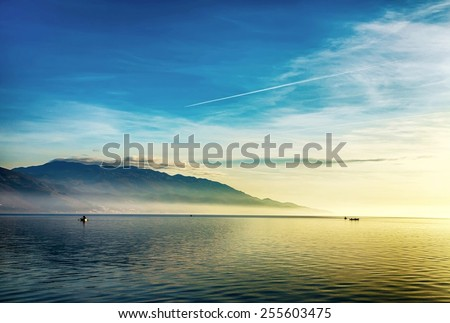 Beautiful landscape with boats and sea - stock photo