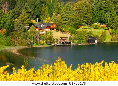 Beautiful landscape with cottage near a lake and trees in Villa La Angostura, Patagonia, Argentina - stock photo