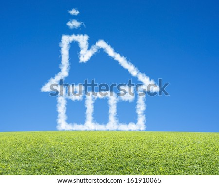 beautiful landscape with green meadow, clean blue sky and dream cloud house - stock photo