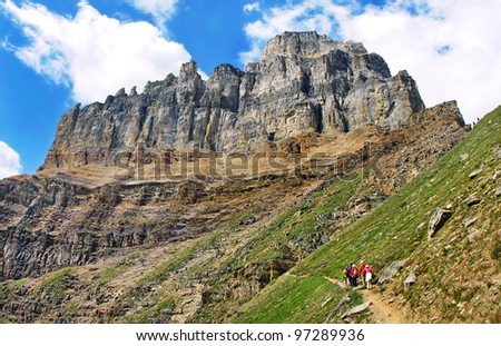 Beautiful landscape with group of tourists hiking in Rocky Mountains, Banff National Park, Alberta, Canada - stock photo
