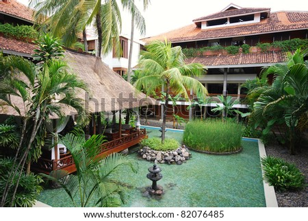 Beautiful landscape with hotel patio,pool, pavilion and palms on tropical resort (Bali) - stock photo