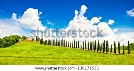Beautiful landscape with house on hill in Val d'Orcia, Tuscany, Italy - stock photo
