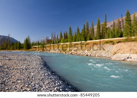 Beautiful landscape with Kootenay River and Canadian Rockies. Photo was taken on sunny day of autumn in Kootenay National Park, British Columbia, Canada - stock photo