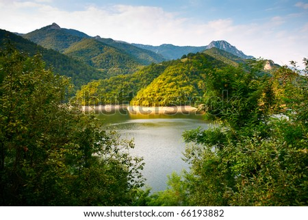 Beautiful landscape with lake and mountains in the evening - stock photo