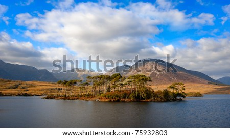 Beautiful Landscape with mountains and sky reflected in lake, Connemara, Ireland - stock photo