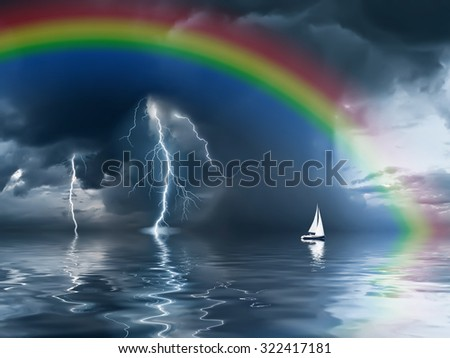 Beautiful landscape with rainbow, lightning and yacht against the background of a stormy sky - stock photo