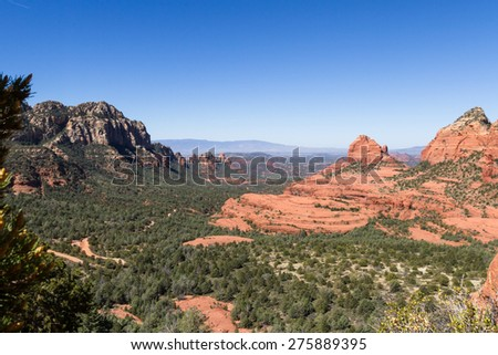 beautiful landscape with red rock formations and the city of Sedona nestled in the valley
