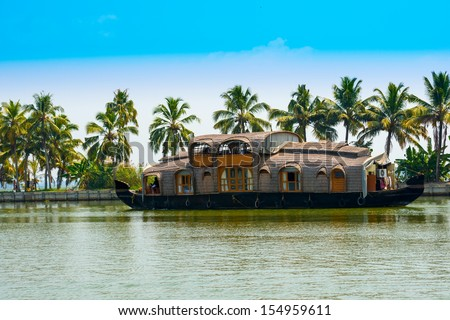 beautiful landscape with reflection houseboat in kerala backwaters, India - stock photo