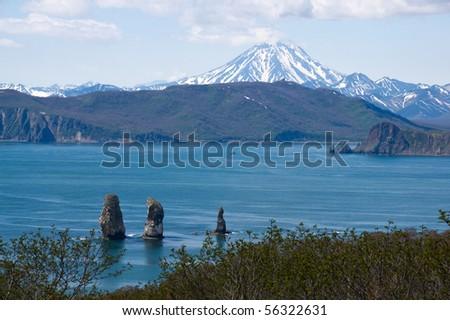 beautiful landscape with rocks and volcano on kamchatka - stock photo