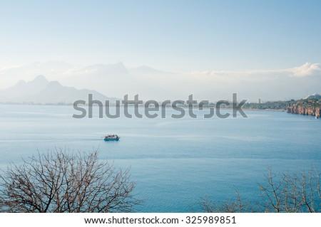 Beautiful landscape with sea bay, mountains and ship. Antalya, Turkey. - stock photo