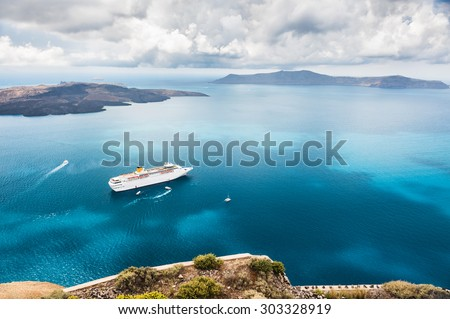 Beautiful landscape with sea view. Cruise liner at the sea near the islands. Santorini island, Greece.  - stock photo