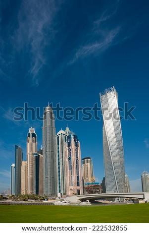 beautiful landscape with skyscrapers in dubai - stock photo