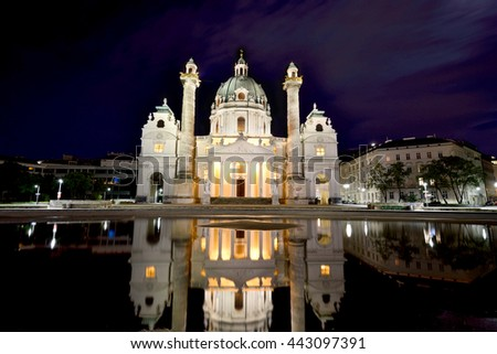 Beautiful landscape with St. Charles's Church (Karlskirche) in Vienna, Austria, Europe at night - stock photo