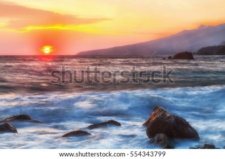 Beautiful landscape with sunrise and big stones, the Black Sea, the Crimea