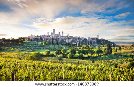 Beautiful landscape with the medieval city of San Gimignano in the background at sunset in Tuscany, province of Siena, Italy - stock photo