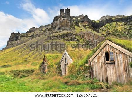Beautiful landscape with traditional turf houses at Nupsstadur farm near Skaftafell National Park, Sandar region, Iceland - stock photo