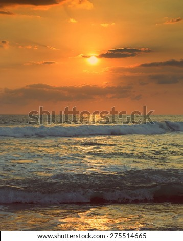 beautiful landscape with tropical sea sunset and waves - vintage retro style - stock photo