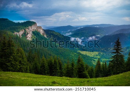 Beautiful landscape with white cliffs after rain. Vladeasa mountains, Romania - stock photo