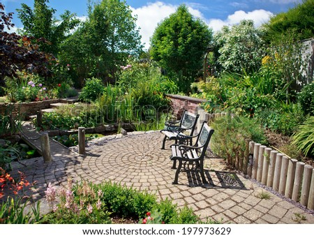 Beautiful landscaped garden with trees, flowers, bridge over the pond