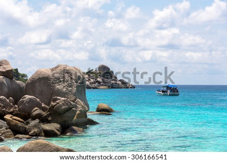 Beautiful landscapes of sky over the sea and tourist boat in the summer at Koh Miang island is a attractions famous for diving in Mu Ko Similan National Park, Phang Nga Province, Thailand