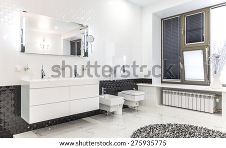 Beautiful Large Bathroom in Luxury Home with double sink, bathtub and bidet - stock photo