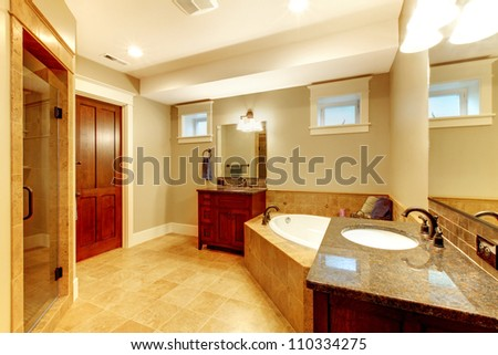 Beautiful large bathroom with two sinks and tub. - stock photo