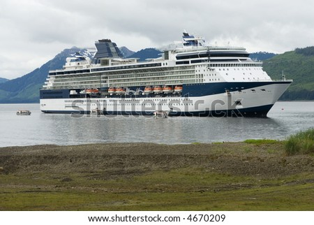 Beautiful large cruise ship boat anchored in Alaska harbor - stock photo