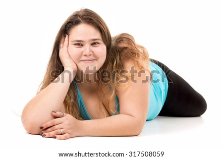 Beautiful large girl posing isolated in white - stock photo
