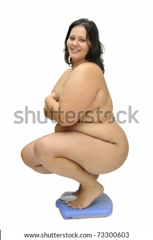 Beautiful large girl with weight scale isolated in white - stock photo