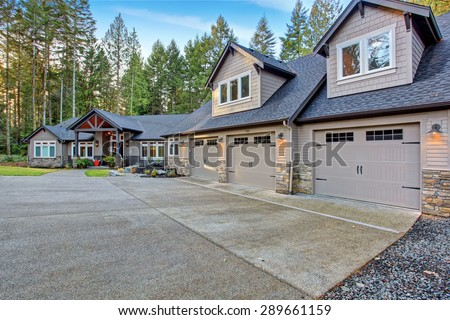 Beautiful large house with driveway, and garage. - stock photo