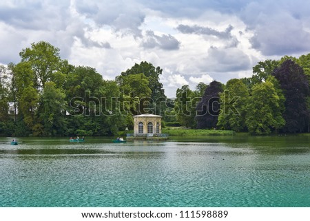 Beautiful large lake near the ancient Fontainebleau palace. Palace of Fontainebleau - one of largest royal chateaux in France (55 km from Paris), UNESCO World Heritage Site. - stock photo