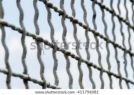 beautiful large metal mesh in the fence