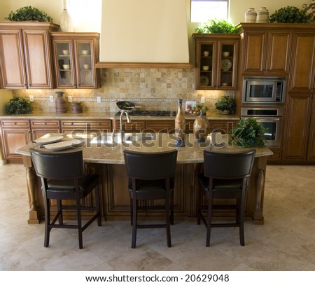 Beautiful large modern kitchen area in new home - stock photo