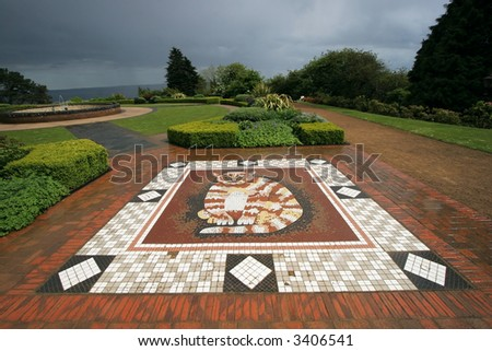 beautiful, large mosaic cat embedded in grounds at Belfast Castle - stock photo