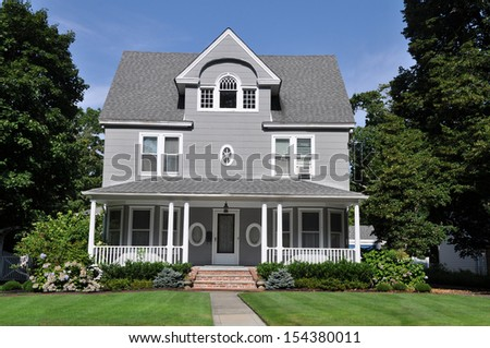 Beautiful Large Suburban Home Manicured Front yard lawn Blooming Rhododendron Flowers Shrubs Plants