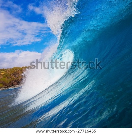 Beautiful Large Surfing Wave Breaks in Ocean with Sunny Blue Sky, Surfers view from water level inside the Tube - stock photo