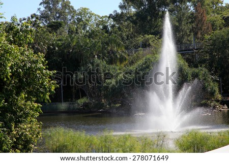 Beautiful large water fountain in park - stock photo