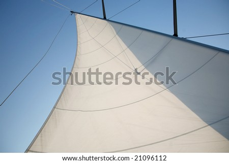 Beautiful large white sail on sailboat. - stock photo