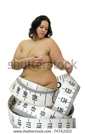 Beautiful large with measuring tape girl isolated in white - stock photo