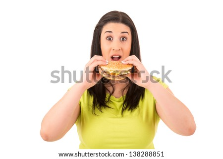 Beautiful large woman, could not resist to an appetizing hamburger, and kills her diet