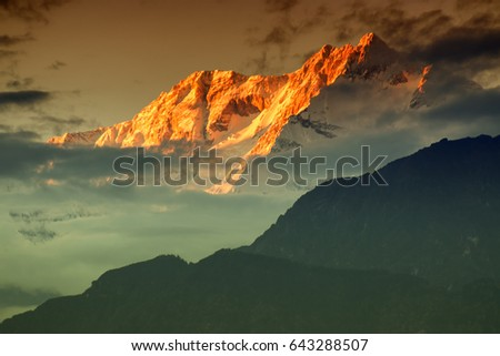 Beautiful last light from sunset on Mount Kanchenjugha, Himalayan mountain range, Sikkim, India. color tint on the mountains at dusk
