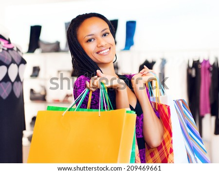 Beautiful  latin american women with packages shopping