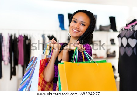 Beautiful  latin american women with packages shopping - stock photo