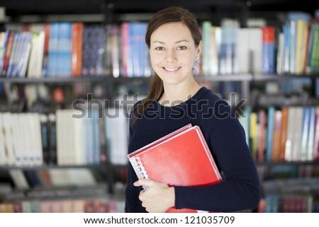 Beautiful latin college student loving school - stock photo