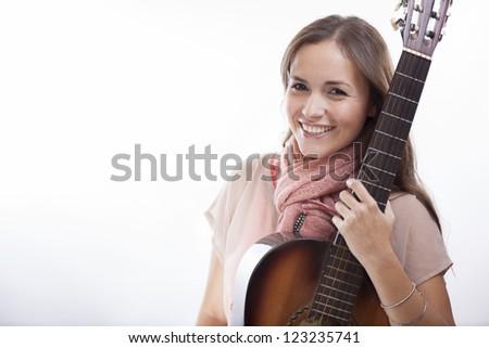 Beautiful latin female singer loving her music - stock photo