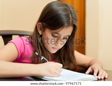 Beautiful latin girl working on her school homework - stock photo