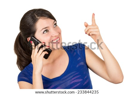 beautiful latin happy young girl talking on her cell phone pointing up isolated on white - stock photo
