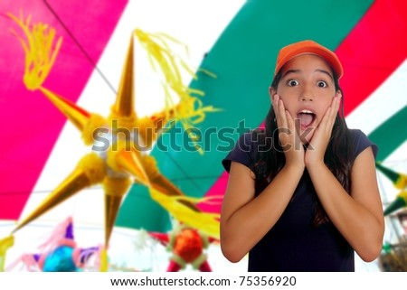 Beautiful Latin teen hispanic girl cap surprise gesture pinata party celebration [Photo Illustration] - stock photo